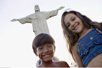 Boy and Girl by Christ Statue