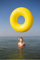 Boy in Water with Inner Tube