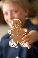 Child Holding Gingerbread Man