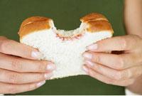 Woman Holding Sandwich