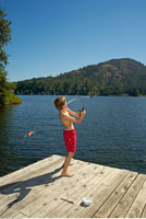 Boy Fishing off Dock