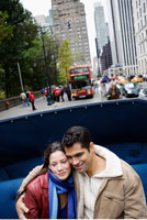 Couple Riding in Carriage
