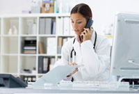 Doctor on Phone in Office