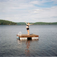 Pregnant Woman Doing Yoga On Floating Dock