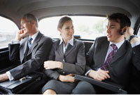 Business People Riding In the Back of A Cab
