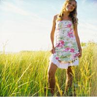 Girl Standing in Long Grass