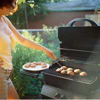 Woman Barbequing
