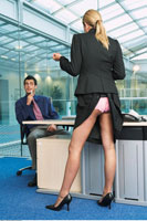 Businesswoman Standing at Businessman's Desk