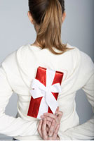 Woman Hiding Gift Behind Back