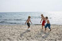 Boys Playing Soccer on Beach