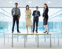 Portrait of Business People Standing on Boardroom Table
