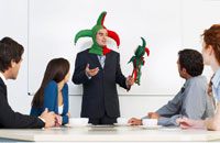 Businessman Holding Meeting in Jester Costume