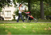 Woman Pushing Baby in Stroller