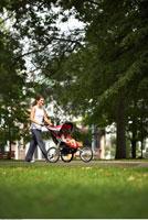 Woman Pushing Baby in Stroller