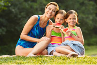 Portrait of Mother and Daughters Outdoors