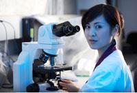 Lab Technician with Microscope