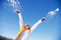 Woman Throwing Snow in Air