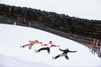 Three Friends Making Snow Angels