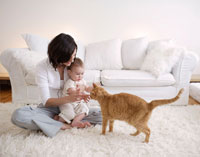 Mother and Son with Cat in Living Room