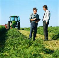 Businessman Talking to Farmer