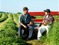 Farmer With Grandson