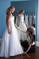 Woman Trying on Wedding Gown