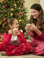 Young Woman and Girl Drinking Hot Chocolate