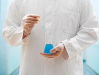 Lab Technician Holding Beaker