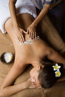 Woman Rceiveing a Coconut Body Scrub