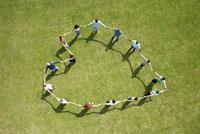 People Standing in Heart Shape
