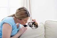 Woman on Sofa with Kitten