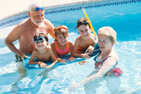 Children with Grandparents in Swimming Pool