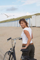 Portrait of Woman with Bicycle on Beach