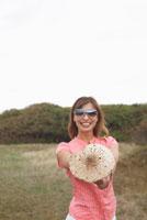 Portrait of Woman Holding Mushroom