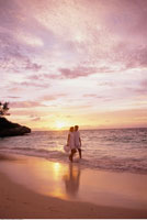 Couple Walking on Beach at Sunset Bahamas