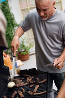 Man Barbequing Meat