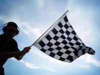 Man Waving Checkered Flag