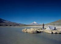 Man Camping Next to Lake
