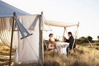 Couple by Tent and Gourmet Dining