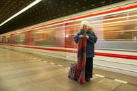 Woman Knitting at Subway Station