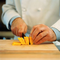 Chef Slicing Cheese