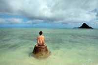 Woman Sitting on Rock in Ocean,Oahu, Hawaii, USA