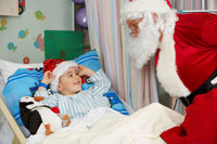 Santa Visiting Boy in Hospital