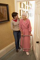Woman Helping Senior Woman Walk