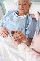 Nurse Giving Medicine to Patient