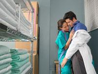 Doctor and Nurse Kissingin Supply Room