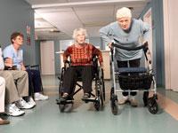Senior Women Racing inHospital Hallway