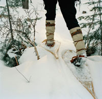 Woman Walking in Snowshoes