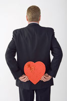 Businessman Holding Heart-ShapedBox