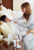 Woman Taking Care of Sick Man